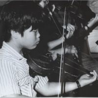 Asian-American Student Practicing the Violin